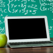 Laptop and apple on the desk — Stock Photo #22154153
