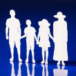 Silhouettes of family members holding hands together — Stock Photo