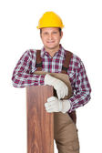 Worker with laminate piece — Stock Photo