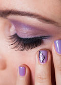 Close-up Of Woman's Eye With Purple Eyeshadow — Foto de Stock