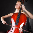 Beautiful young woman playing cello - Stock Photo