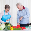 Senior Couple Cutting Vegetables — Stock Photo