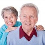 Senior Couple Enjoying Piggyback Ride — Stock Photo #22357285