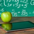 Digital tablet and apple on desk — Stockfoto #22357645