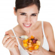 Healthy Woman Eating Fruit Salad — Stock Photo #22357903