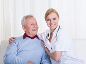 Portrait Of Happy Doctor And Patient — Stock Photo