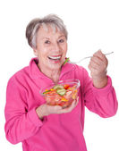 Senior Woman Eating Salad — Stock Photo