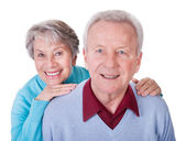 Senior Couple Enjoying Piggyback Ride — Stock Photo