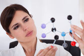 Scientist Looking At Dna Molecular Structure — Stock Photo