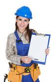 Female Worker Showing Blank Clipboard — Stock Photo