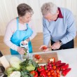 Senior Couple Cutting Vegetables — Stock Photo #22740703