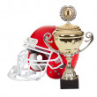 American football helmet and trophy - Stock Photo