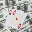 Pair of aces and american dollars - Stock Photo