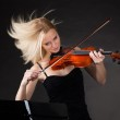 Young woman passionately playing violin — Stock Photo