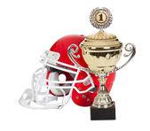 American football helmet and trophy — Stock fotografie