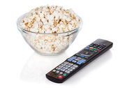 Close-up Of Remote Control And Bowl Of Popcorn — Stok fotoğraf
