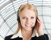 Cheerful call center operator — Stock Photo