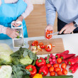 Senior Couple Cutting Vegetables - Stock Photo