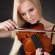 Beautiful young woman playing violin — Stock Photo #23078328
