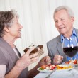 Royalty-Free Stock Photo: Senior Man Giving Gift To Senior Woman