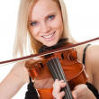 Beautiful young woman playing violin — Stock Photo