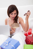 Woman Surprised By Opening Gift — Stock Photo
