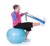 Senior Woman Stretching Exercising Equipment — Stock Photo