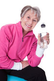 Senior Woman Holding Water Bottle — Stock Photo