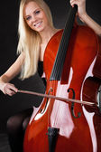 Beautiful young woman playing cello — Stock Photo