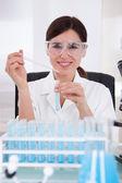 Female Researcher Holding Up A Test Tube — ストック写真