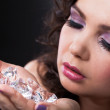 Young Woman Holding Diamonds — Stock Photo #23527695