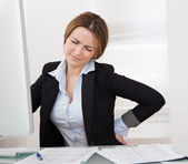 Businesswoman With Back Pain — Stock Photo