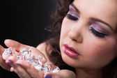 Young Woman Holding Diamonds — Stock Photo