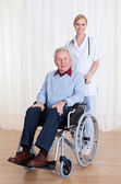 Caring Doctor Helping Handicapped Patient — Stock Photo