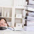 Businesswoman Looking At Stack Of Folders — Stock Photo #23871065