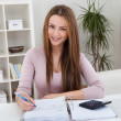 Young Woman Calculating Bills — Stock Photo