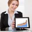 Businesswoman Presenting Charts On Digital Tablet — Stock Photo #23871167