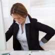 Businesswoman With Back Pain — Stock Photo #23871397