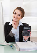 Businesswoman Showing Calculator — Stock Photo