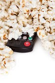 Close-up Of Remote Control And Popcorn — Stock Photo