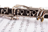 Close-up Of Clarinet And Musical Notes — Stock Photo