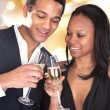 African Couple Enjoying Champagne Drink — Stock Photo #24298181