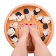 Female Feet Getting Aroma Therapy - Stock Photo