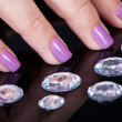 Close-up Of Fingernails And Diamonds - Stock Photo