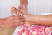 Hand Massaging Foot In Spa — Stock Photo