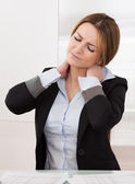 Young Attractive Businesswoman Suffer From Neck Pain — Stock Photo