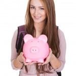 Female Student Holding Piggybank — Stock Photo