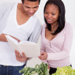 Couple Reading The Book Of Recipes — Stock Photo