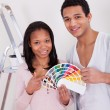 African Couple Choosing Color For New Home — Stock Photo