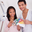 African Couple Choosing Color For New Home - Stock Photo